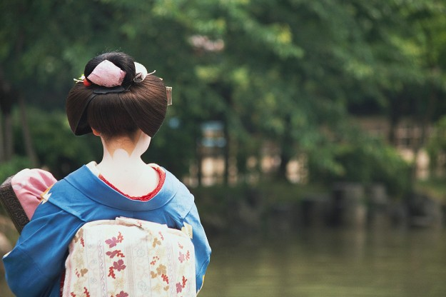 Japanese Woman Wearing Kimono Looking at Pool